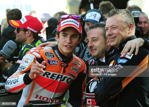 Honda's Marc Marquez with mechanics after qualifying in pole position at Silverstone Northamptonshire