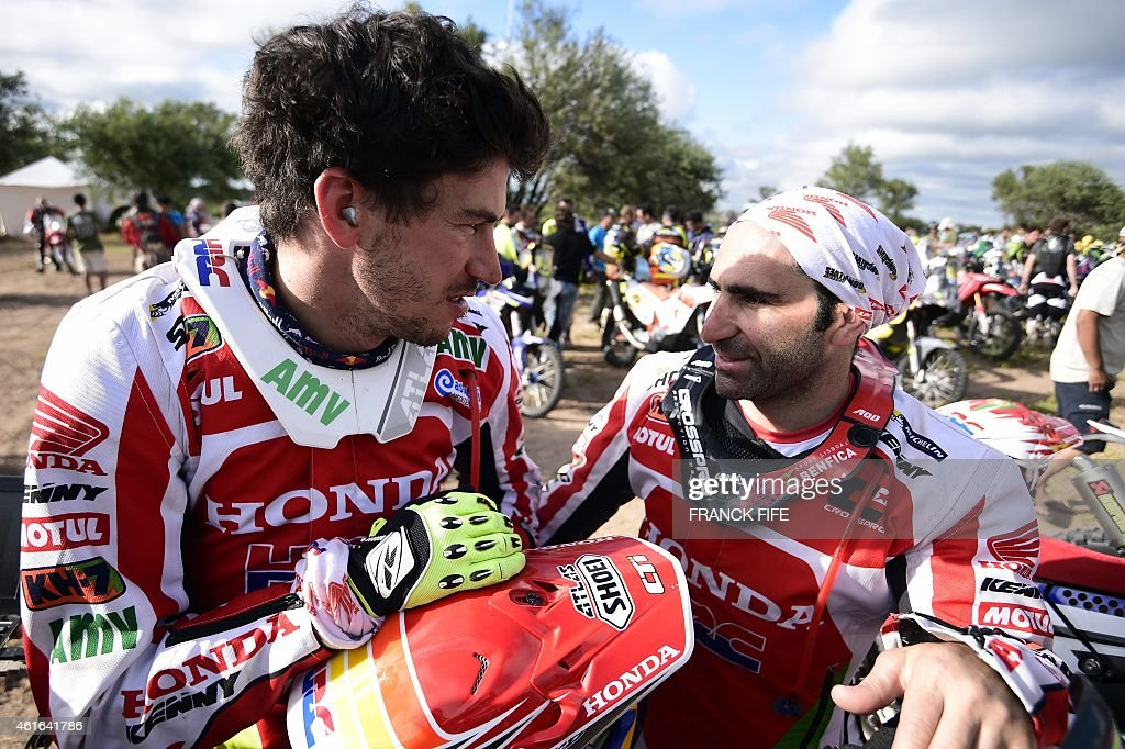 Honda's Portuguese biker Paulo Goncalvez (R) speaks with Honda's Spanish biker <a gi-track='captionPersonalityLinkClicked' href=/galleries/search?phrase=Joan+Barreda+Bort&family=editorial&specificpeople=8767813 ng-click='$event.stopPropagation()'>Joan Barreda Bort</a> before Stage 12 of the 2015 Dakar Rally between Termas de Rio Hondo and Rosario, Argentina, on January 16, 2015. AFP PHOTO / FRANCK FIFE