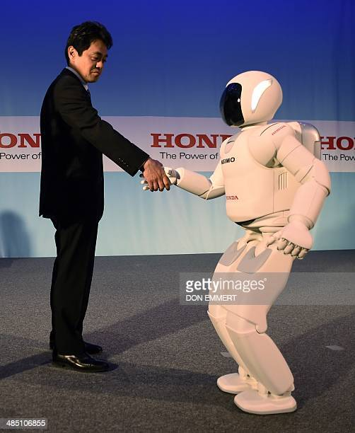 Honda's Satoshi Shigemi works with Asimo Robot as Honda North America makes their North American debut of Asimo Robot at a news conference...