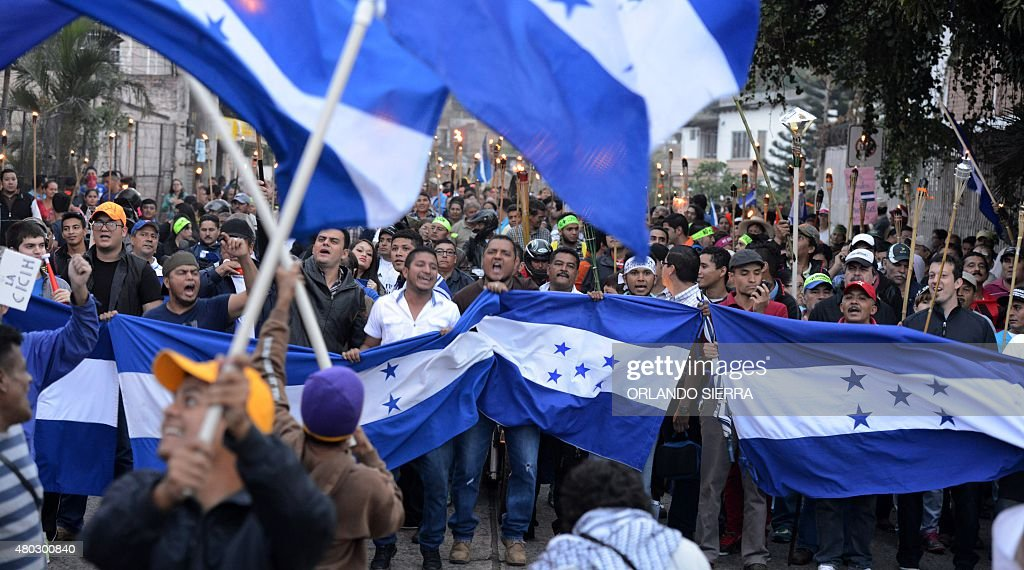 Honduran demonstrators march in protest against the alleged corruption in the government of President Juan Orlando Hernandez and demanding the...