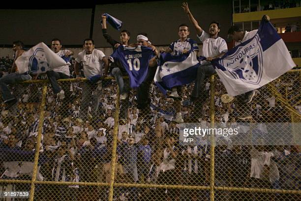 Honduran fans celebrate after they won their game against El Salvador at the Cuscatlan Stadium in San Salvador El Salvador Honduras clasicate to the...