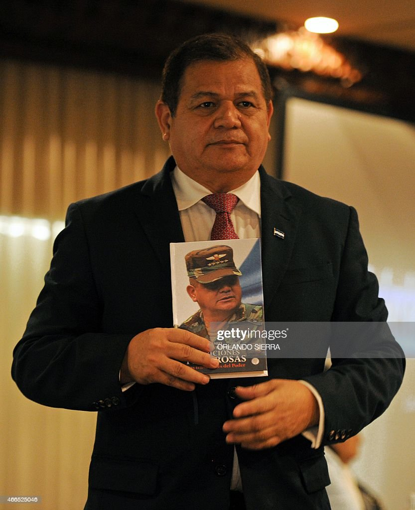 Honduran Gen (r) Romeo Vasquez Velasquez --who led the 2009 coup d'etat against the then President Manuel Zelaya-- poses for a picture during the presentation of his book 'Dangeorus ambitions: the temptations of power' in Tegucigalpa,on March 16, 2015. AFP PHOTO/ORLANDO SIERRA
