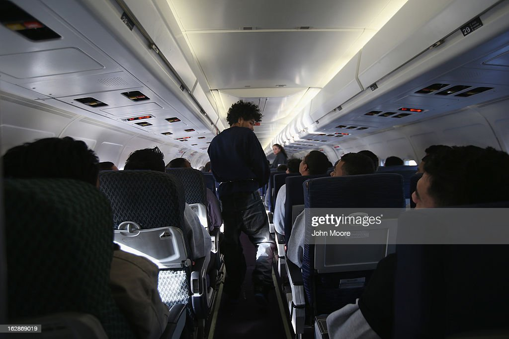 A Honduran immigration detainee boards a deportation flight to San Pedro Sula, Honduras on February 28, 2013 in Mesa, Arizona. U.S. Immigration and Customs Enforcement (ICE), operates 4-5 flights per week from Mesa to Central America, deporting hundreds of undocumented immigrants detained in western states of the U.S. With the possibility of federal budget sequestration, ICE released 303 immigration detainees in the last week from detention centers throughout Arizona. More than 2,000 immigration detainees remain in ICE custody in the state. Most detainees typically remain in custody for several weeks before they are deported to their home country, while others remain for longer periods while their immigration cases work through the courts.