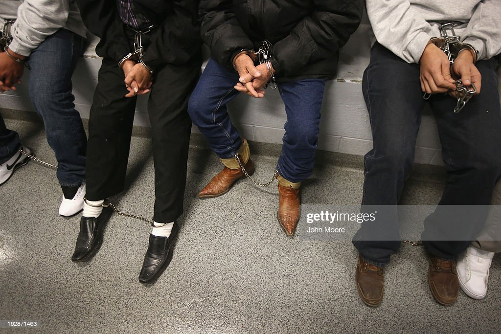 Honduran immigration detainees sit in a holding cell before boarding a U.S. Immigration and Customs Enforcement (ICE), deportation flight bound for San Pedro Sula, Honduras on February 28, 2013 in Mesa, Arizona. ICE operates 4-5 flights per week from Mesa to Central America, deporting hundreds of undocumented immigrants detained in western states of the U.S. With the possibility of federal budget sequestration, ICE released 303 immigration detainees in the last week from detention centers throughout Arizona. More than 2,000 immigration detainees remain in ICE custody in the state. Most detainees typically remain in custody for several weeks before they are deported to their home country, while others remain for longer periods while their immigration cases work through the courts.