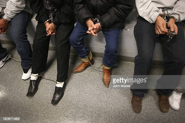 Honduran immigration detainees sit in a holding cell before boarding a US Immigration and Customs Enforcement deportation flight bound for San Pedro...