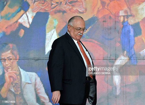 Honduran leader of the Liberal Party Jaime Rosenthal Oliver leaves the presidential palace in Tegucigalpa on July 9 2011 The leaders of different...