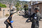 Honduran Military Policemen patrol the southern outskirts of Tegucigalpa on October 14 during a government operation aiming at stopping gang violence...