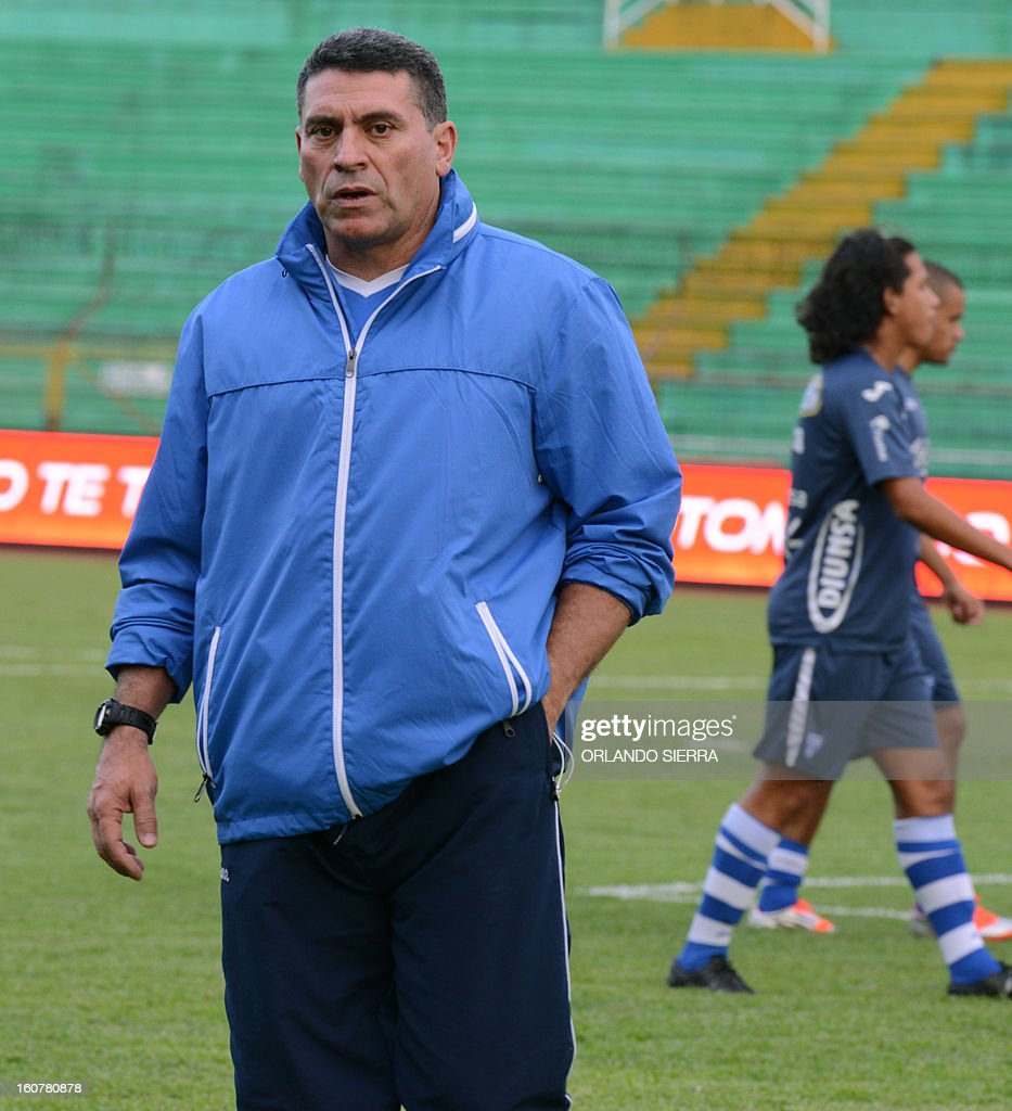 Honduran national football team coach Luis Fernando Suarez walks during a training session, at the Olimpico Metropolitano stadium, in San Pedro Sula, 240 km north of Tegucigalpa, on February 5, 2013. Honduras will face the US on February 6 in a Brazil 2014 FIFA World Cup Concacaf qualifier football match. AFP PHOTO/Orlando SIERRA