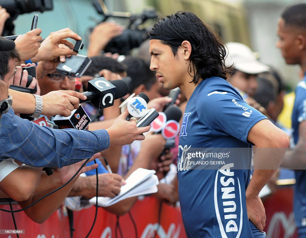 Honduran national footballer Roger Espinoza speaks with journalists after a training session, at the Olimpico Metropolitano stadium, in San Pedro Sula, 240 km north of Tegucigalpa, on February 5, 2013. Honduras will face the US on February 6 in a Brazil 2014 FIFA World Cup Concacaf qualifier football match. AFP PHOTO/Orlando SIERRA