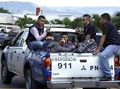 Honduran policemen escort five Syrian citizens arrested at the Tocontin international airport in Tegucigalpa on November 18 2015 Honduran authorities...