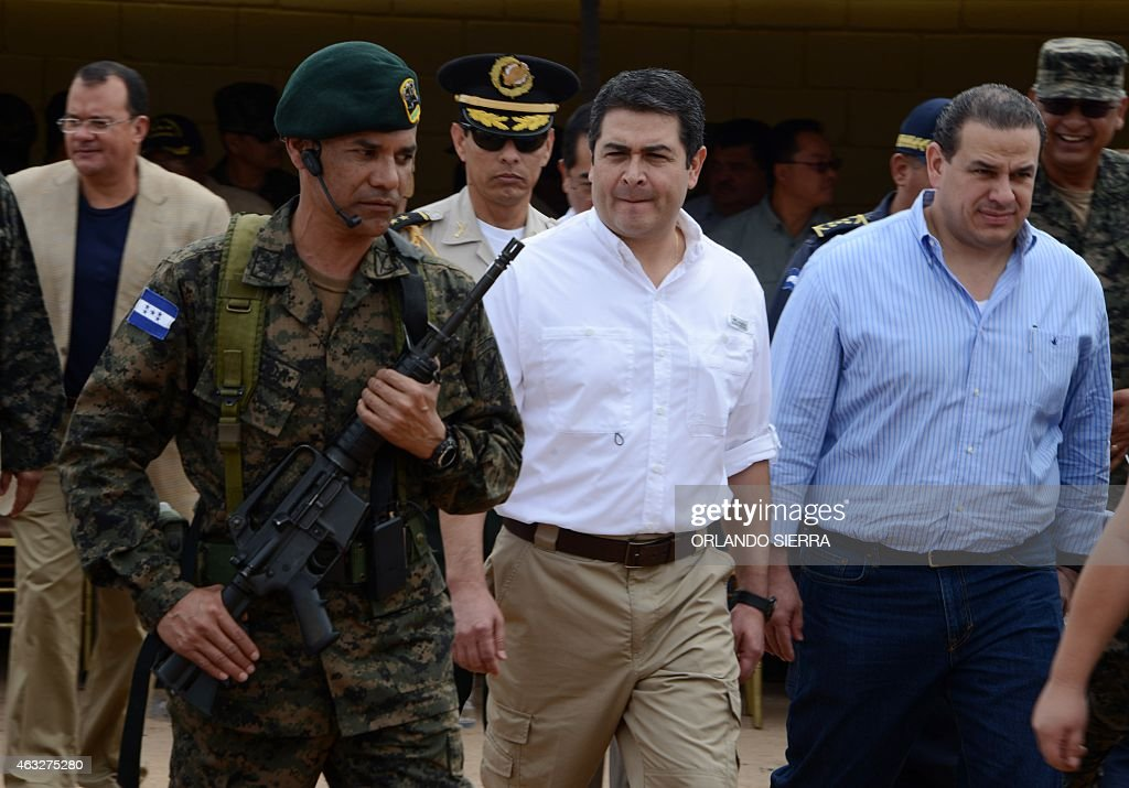 Honduran President Juan Orlando Hernandez (C)arives at the Complejo de Rehabilitacion Social de Adultos El Porvenir prison complex in El Porvenir, Francisco Morazan department, 90 km north of Tegucigalpa on February 12, 2015. The prison was built by Honduran army engineers on land seized to people linked to drug trafficking and organized crime. AFP PHOTO/Orlando SIERRA.