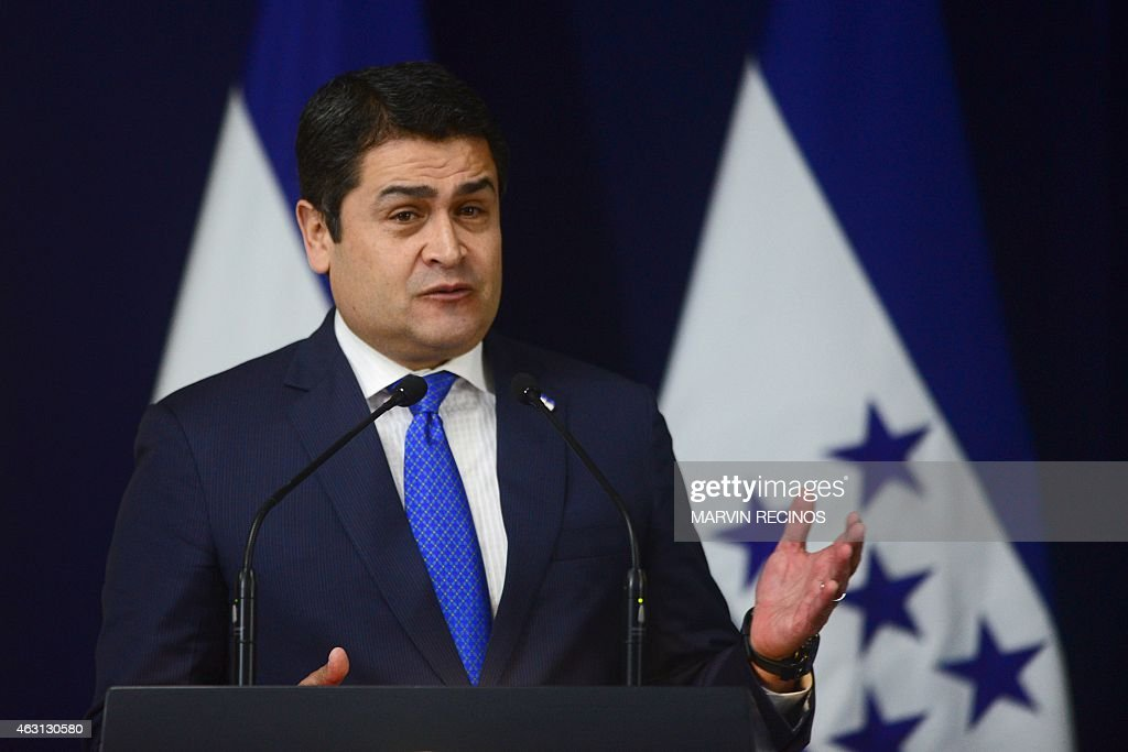 Honduran President Juan Orlando Hernandez speaks during a press conference at the presidential house in San Salvador, on February 10, 2015. Hernandez arrived in San Salvador to strengthen bilateral ties between both countries, and to promote a series of projects to convert the Gulf of Fonseca in an area with economic and social development. AFP PHOTO / Marvin RECINOS