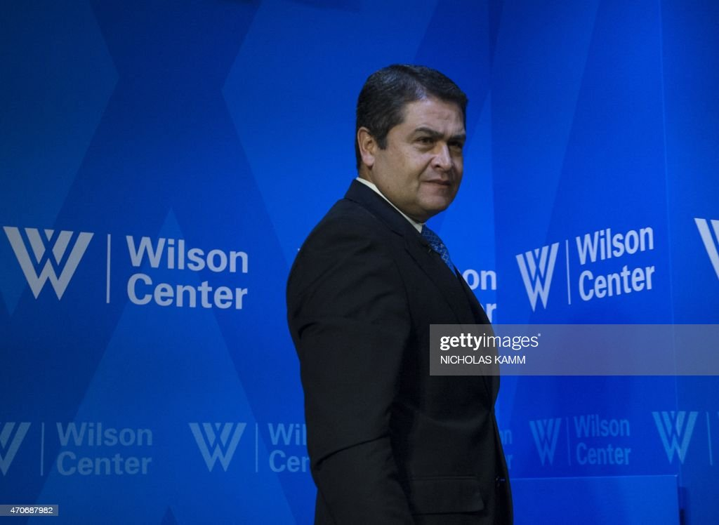Honduran President Juan Orlando Hernandez walks off stage after speaking at a discussion on promoting peace and prosperity in Honduras at the Wilson Center in Washington, DC, on April 22, 2015.