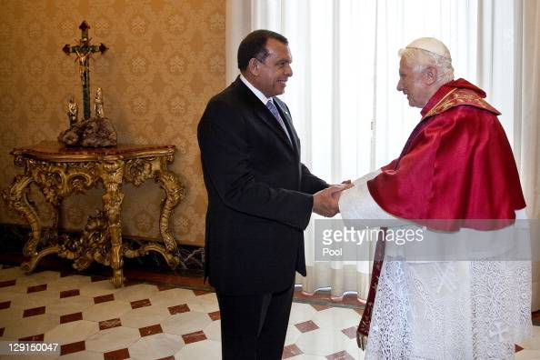 Honduran President Porfirio Lobo Sosa shakes hands with Pope Benedict XVI at his private library on October 13 2011 in Vatican City the Vatican