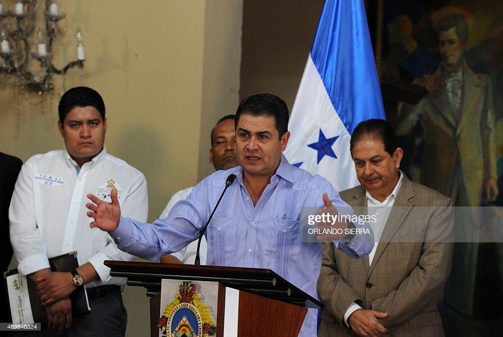 Honduran Presidnet Juan Orlando Hernandez speaks as he declares a forest emergency due to weevil plague affecting pine woods in Tegucigalpa on August...