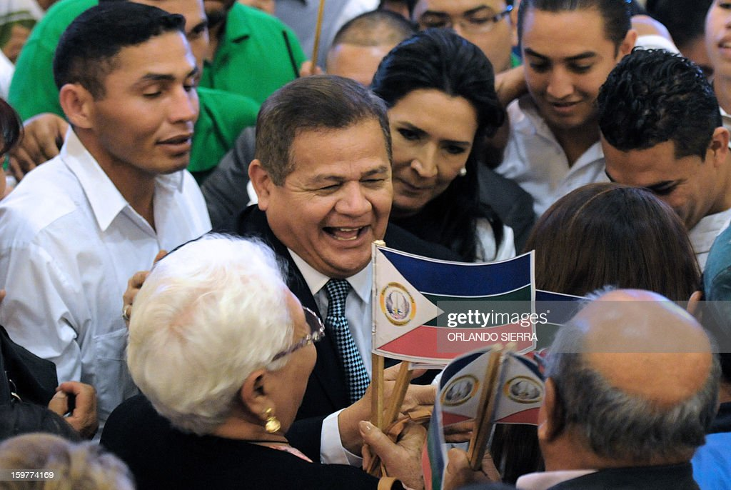 Honduran retired General Romeo Vasquez Velasquez greets supporters during the lauching of his candidacy to the Honduran Presidency for the Honduran Patriotic Alliance in Tegucigalpa, on January 20, 2013. Vasquez was head of the Armed Forces of Honduras from January 11, 2005 to January 25, 2010. AFP PHOTO / Orlando SIERRA