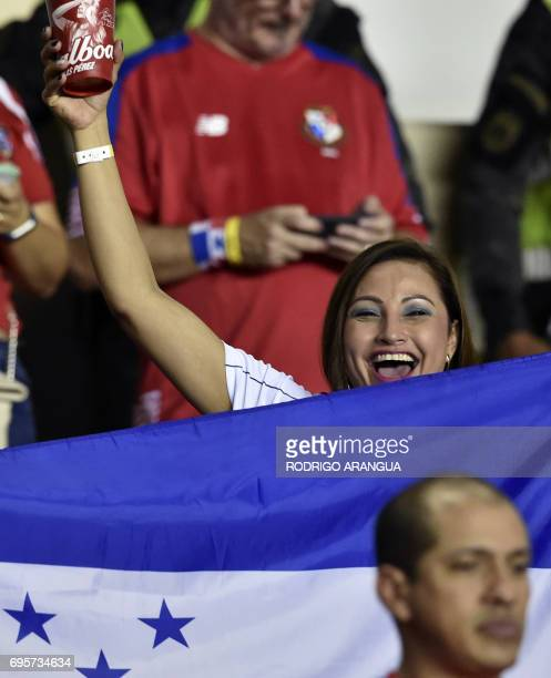 A Honduran supporter waits with a national flag for the beginning of the FIFA World Cup Russia 2018 Concacaf qualifier match against Panama in Panama...