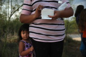 Honduran undocumented immigrant Laura Fabio 2 waits for her mother after they crossed the Rio Grande illegally into the United States on July 24 2014...