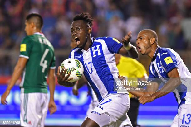 Honduras' Alberth Elis and Eddie Hernandez celebrate after scoring against Mexico during their 2018 World Cup qualifier football Match in Olimpico...