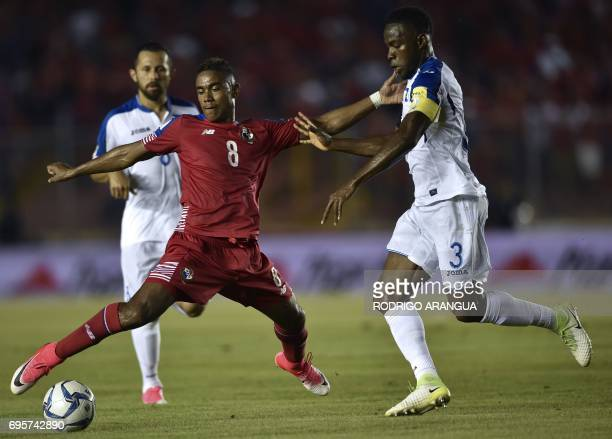 Honduras' Alfredo Mejia vies for the ball with Honduras' defender Maynor Figueroa during a FIFA World Cup Russia 2018 Concacaf qualifier match in...