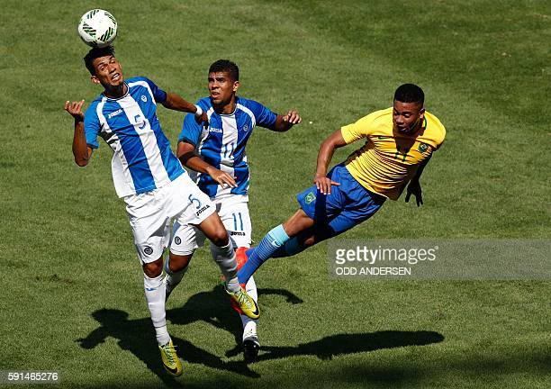 Honduras' Allans Vargas heads the ball next to Honduras' Marcelo Espinal and Brazil's Gabriel Jesus during their Rio 2016 Olympic Games men's...