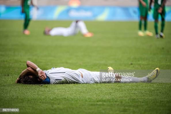 TOPSHOT Honduras' Allans Vargas lies on the ground in dejection after being defeated by Nigeria in the Rio 2016 Olympic Games men's bronze medal...