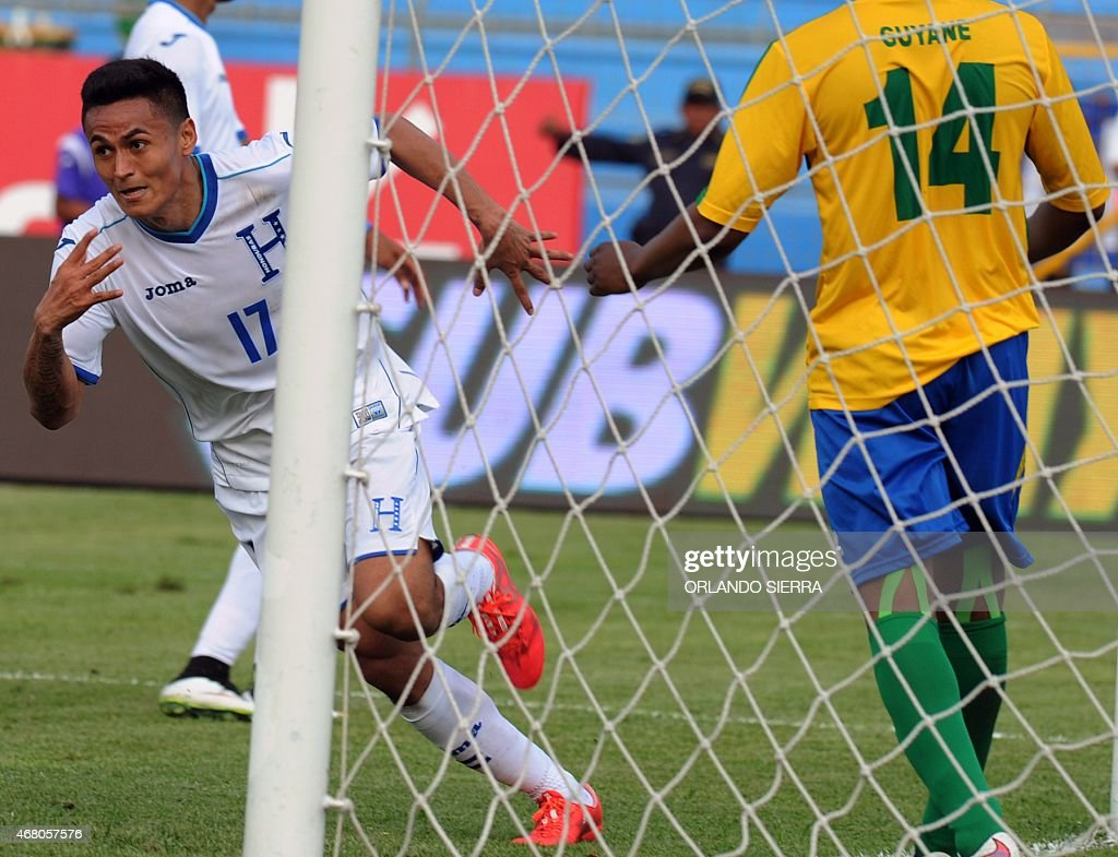 Honduras' <a gi-track='captionPersonalityLinkClicked' href=/galleries/search?phrase=Andy+Najar&family=editorial&specificpeople=6872158 ng-click='$event.stopPropagation()'>Andy Najar</a> (L) celebrates after scoring the team's second goal against French Guiana during the Concacaf Gold Cup qualifying playoff match,, at the Olimpico Metropolitano stadium in San Pedro Sula, 240 km north of Tegucigalpa, on March 29, 2015. The Concacaf Gold Cup will be held in United States and Canada from July 7 to 26.