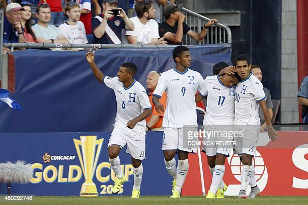 Honduras' Andy Najar celebrates his goal with his teammates during the CONCACAF Gold Cup match between Honduras and Panama in Foxborough...