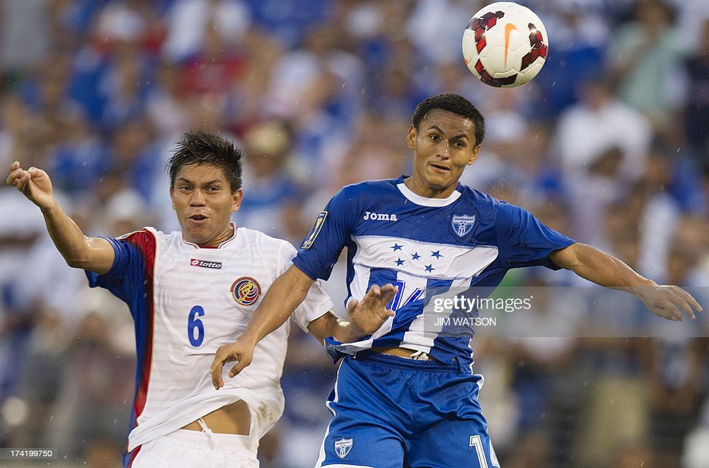 Honduras' Andy Najar (R) vies for a header with Costa Rica's Juan Diego Madrigal (L) during a CONCACAF Gold Cup quarterfinal match in Baltimore on July 21, 2013.