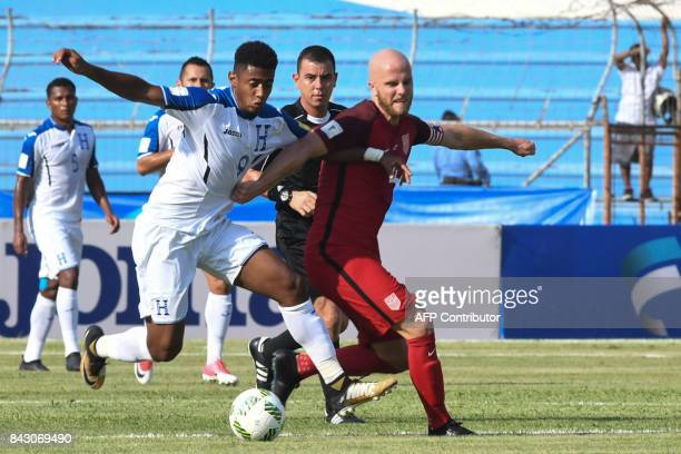Honduras' Anthony Lozano and USA's Michael Bradley vie for the ball during their 2018 World Cup qualifier football match in San Pedro Sula Honduras...
