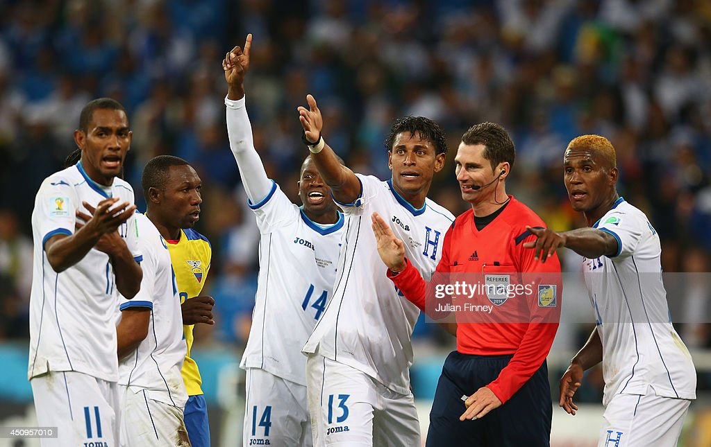 Honduras appeal to referee Benjamin Williams after a call during the 2014 FIFA World Cup Brazil Group E match between Honduras and Ecuador at Arena da Baixada on June 20, 2014 in Curitiba, Brazil.