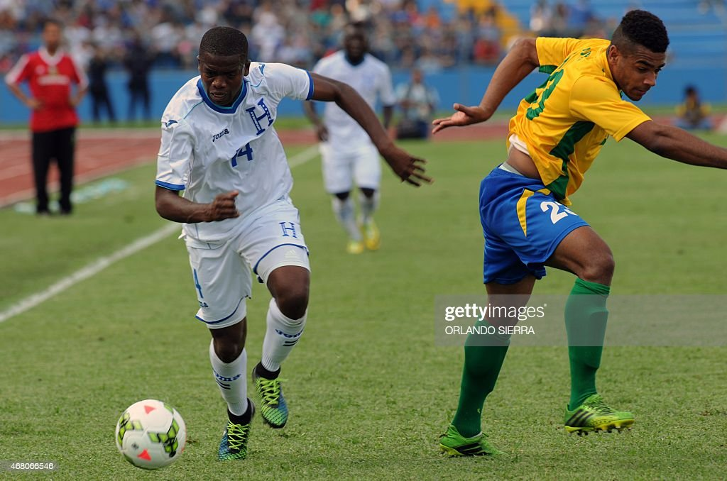 Honduras' Bonieck Garcia (L) vies for the ball with David Legrand of French Guiana during the Concacaf Gold Cup qualifying playoff match, at the Olimpico Metropolitano stadium in San Pedro Sula, 240 km north of Tegucigalpa, on March 29, 2015. The Concacaf Gold Cup will be held in United States and Canada from July 7 to 26.