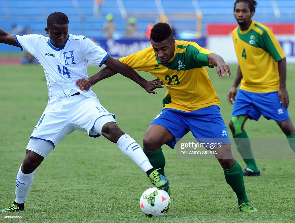 Honduras' Bonieck Garcia vies for the ball with David Legrand of French Guiana during the Concacaf Gold Cup qualifying playoff match at the Olimpico...