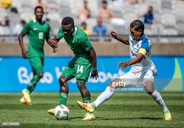 Honduras' Bryan Acosta marks Nigeria's Okechukwu Azubuike during the Rio 2016 Olympic Games men's bronze medal football match at the Mineirao stadium...