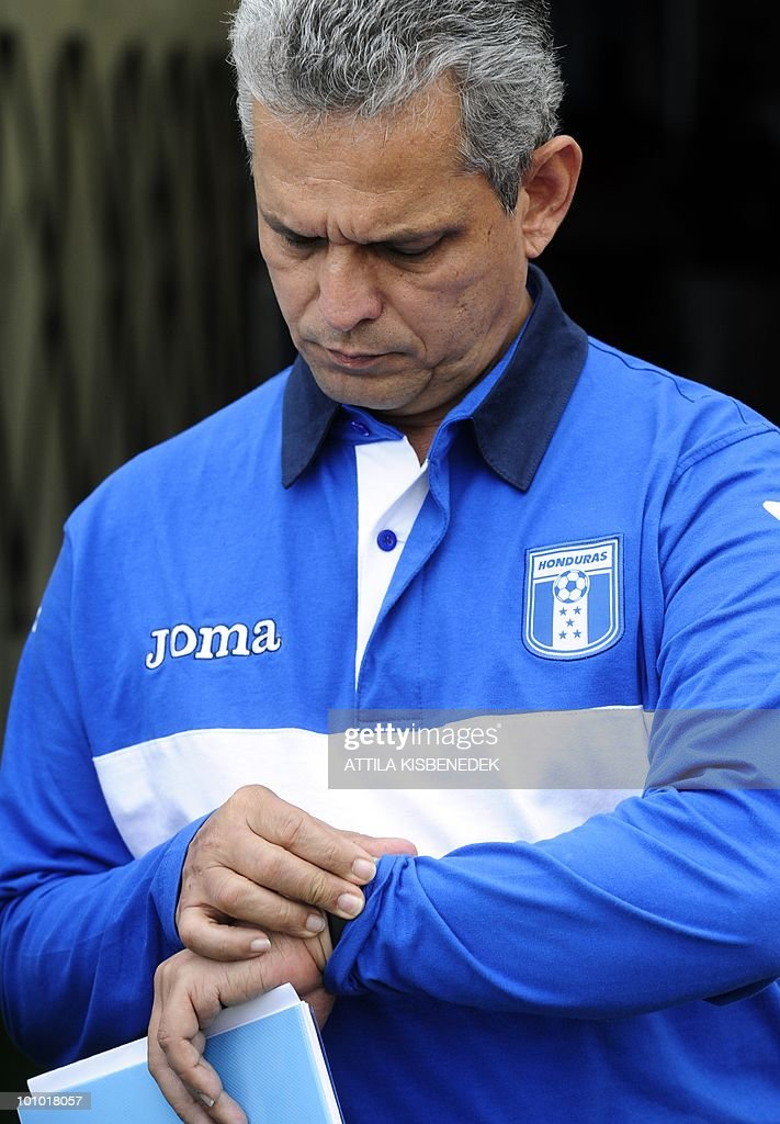 Honduras' coach, Columbian Reinaldo Rueda looks at his watch prior to their friendly match against Belarus in the local stadium of Villach, on May 27, 2010 prior to the FIFA World Cup 2010 hosted by SouthAfrica between June 11 and July 11. The match ended with 2-2 equal.