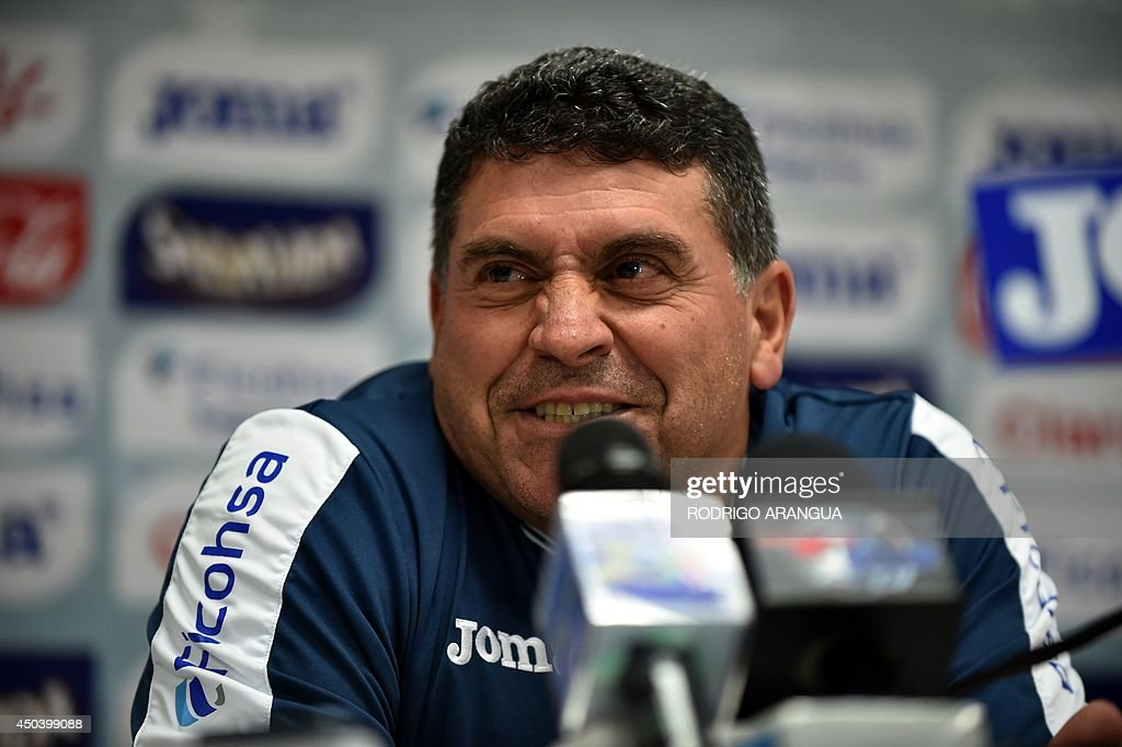 Honduras coach <a gi-track='captionPersonalityLinkClicked' href=/galleries/search?phrase=Luis+Fernando+Suarez+-+Soccer+Coach&family=editorial&specificpeople=548216 ng-click='$event.stopPropagation()'>Luis Fernando Suarez</a> reacts during a press conference in Porto Feliz, on June 10, 2014, two days before the start of the 2014 FIFA World Cup Brazil. AFP PHOTO/ Rodrigo ARANGUA