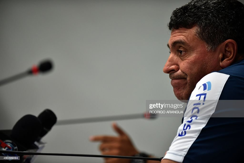 Honduras coach <a gi-track='captionPersonalityLinkClicked' href=/galleries/search?phrase=Luis+Fernando+Suarez+-+Fu%C3%9FballtrainerCoach&family=editorial&specificpeople=548216 ng-click='$event.stopPropagation()'>Luis Fernando Suarez</a> reacts during a press conference in Porto Feliz, on June 10, 2014, two days before the start of the 2014 FIFA World Cup Brazil. AFP PHOTO/ Rodrigo ARANGUA