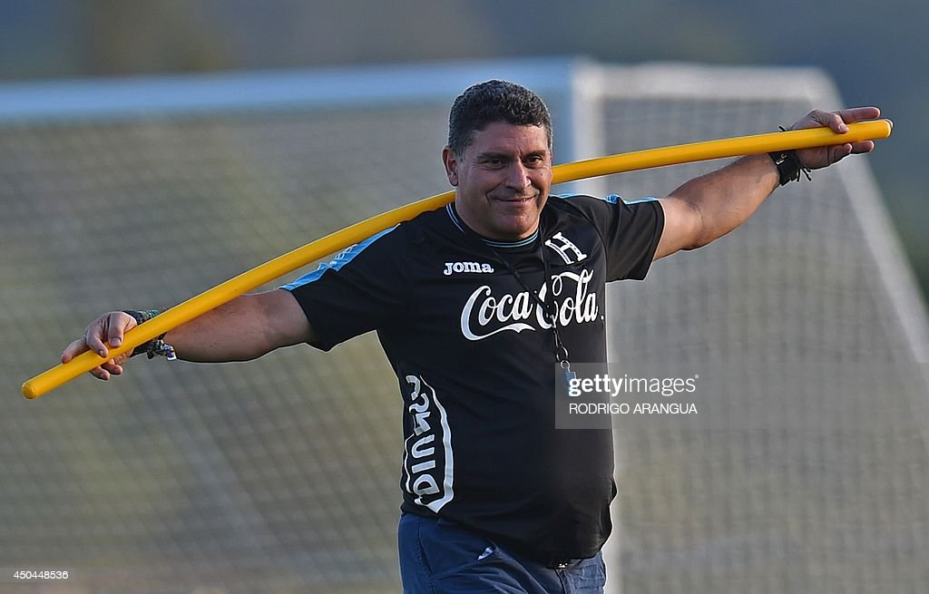 Honduras' Colombian coach <a gi-track='captionPersonalityLinkClicked' href=/galleries/search?phrase=Luis+Fernando+Suarez+-+Soccer+Coach&family=editorial&specificpeople=548216 ng-click='$event.stopPropagation()'>Luis Fernando Suarez</a> smiles during training session in Porto Feliz, Brazil on 11 June , 2014, on the eve of the opening game of the 2014 FIFA World Cup tournament. AFP PHOTO/ Rodrigo ARANGUA