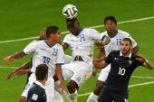 Honduras' defender Maynor Figueroa head the ball during a Group E football match between France and Honduras at the BeiraRio Stadium in Porto Alegre...