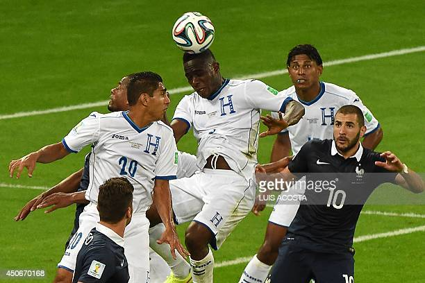 Honduras' defender Maynor Figueroa head the ball during a Group E football match between France and Honduras at the BeiraRio Stadium in Porto Alegre...