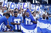 Honduras fans cheer before the CONCACAF Gold Cup match between Honduras and Panama in Foxborough Massachusetts on July 10 2015 AFP PHOTO/ DOMINICK...