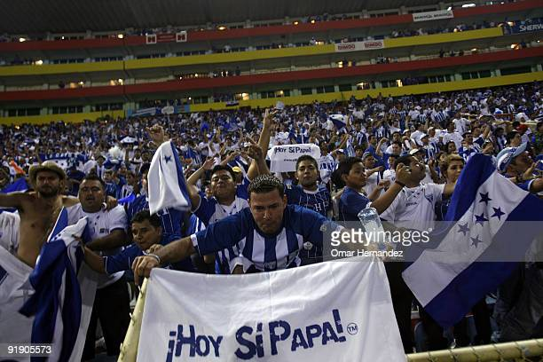 Hondura's fans cheer their team during the match against El Salvador as part of FIFA 2010 World Cup Qualifier at Cuscatlan Stadium on October 14 2009...