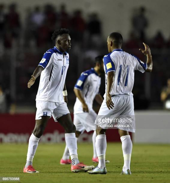 Honduras' forward Alberth Elis celebrates with Honduras' Rony Martinez after scoring against Panama during a FIFA World Cup Russia 2018 Concacaf...