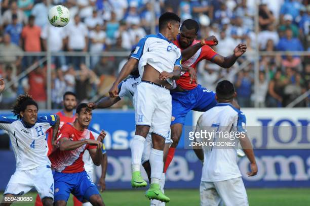 Honduras' forward Anthony Lozano and Costa Rica's defender Kendall Waston jump for the ball during their 2018 FIFA World Cup qualifier football match...