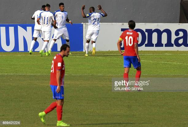 Honduras' forward Anthony Lozano celebrates with teammates after scoring against Costa Rica during their 2018 FIFA World Cup qualifier football match...