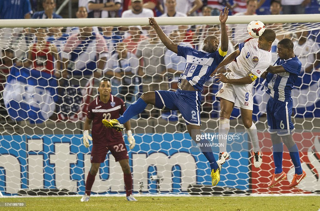 Honduras' goalkeeper Donis Escober (L) watches as teammates Osman Chavez (C) and Juan Carlos Garcia (R) vie for a header with Costa Rica's Alvaro Soborio (2nd R) during a CONCACAF Gold Cup quarterfinal match in Baltimore on July 21, 2013. Honduras won 1-0.