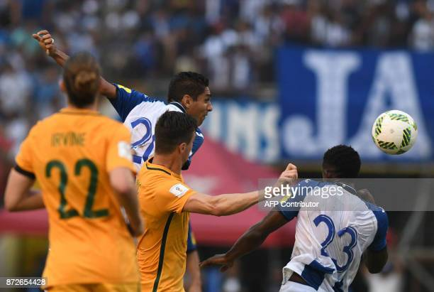 Honduras' Jorge Claros jumps for the ball next to Australia's Tomi Juric during the first leg football match of their 2018 World Cup qualifying...