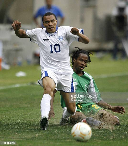 Honduras' Julio Cesar Leon avoids a tackle by Miguel Comminges Guadeloupe defeated Honduras 21in quarter final action at the CONCACAF 2007 Gold Cup...
