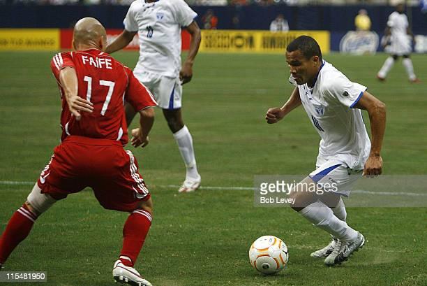 Honduras' Julio Cesar Leon makes a move on Cuba's Pedro Adriani FAIFE Honduras defeated Cuba 50 during the CONCACAF Gold Cup 2007 match between Cuba...