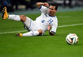 Honduras' midfielder Arnold Peralta looks at the ball while falling on the pitch during their friendly football match against Japan in Toyota Aichi...